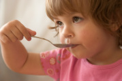 Image of child eating with a spoon