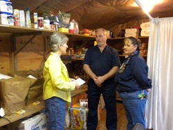 Image of board member and pantry volunteers