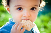 Image of child eating a cookie