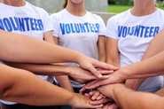 Image of volunteer team with their hands stacked
